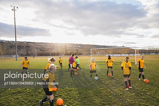 Soccer team practicing training drills