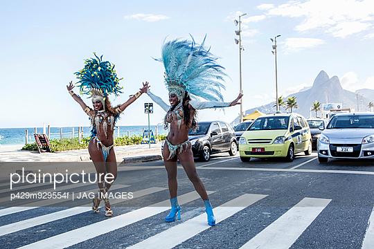 Samba dancers stopping traffic, Ipanema Beach, Rio De Janeiro, Brazil