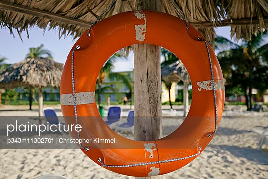 A life ring hangs under a lifegaurd\'s umbrella outside a resort beach in Cayo Coco, Cuba.