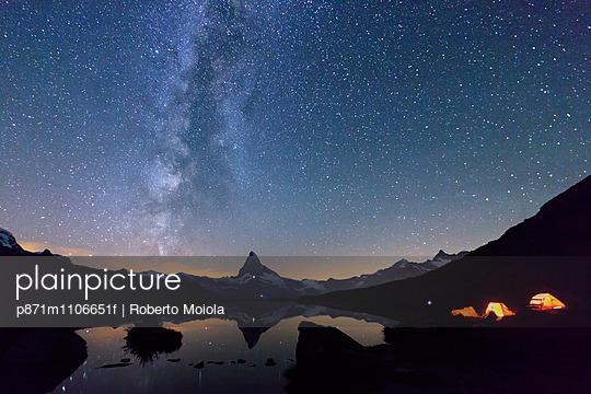 Camping under the stars and Milky Way with Matterhorn reflected in Lake Stellisee, Zermatt, Canton of Valais, Swiss Alps, Switzerland, Europe