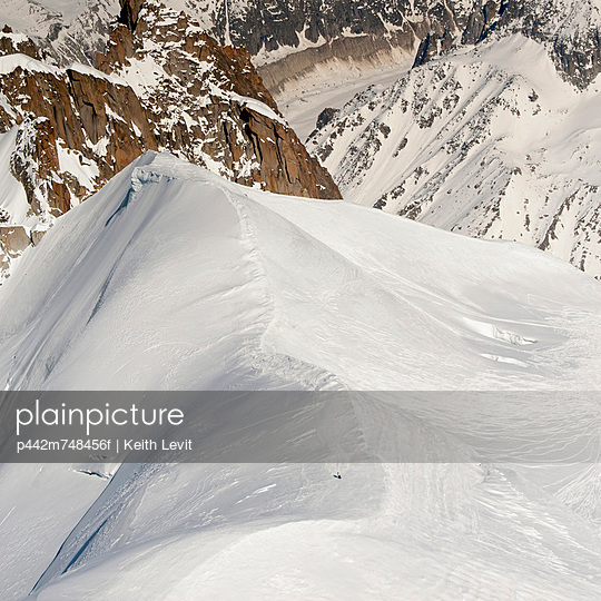 Snow Covered Mountain In A Rugged Mountain Range; Chamonix-Mont-Blanc Rhone-Alpes France