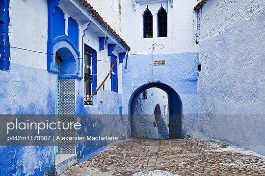 Blue painted buildings in the backstreets of Chefchaouen medina; Chefchaouen, Morocco