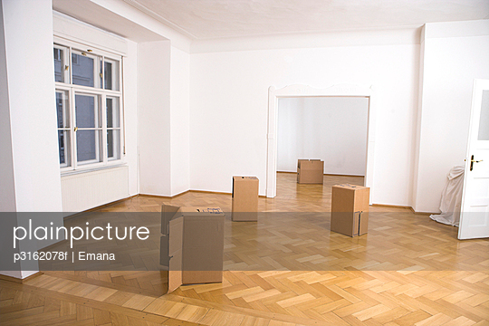 still life of carton boxes in empty apartment