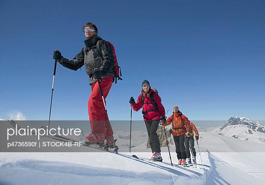 Ski mountaineers ascending mountain