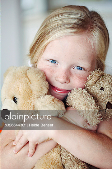 Young girl with teddy bears