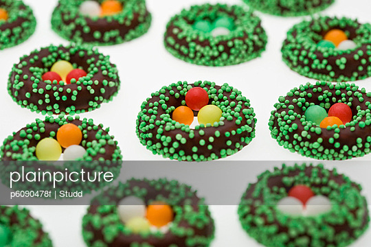 Chocolate Easter egg nests covered in candy sprinkles