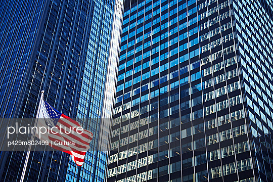 Office exterior and US flag, New York City, USA