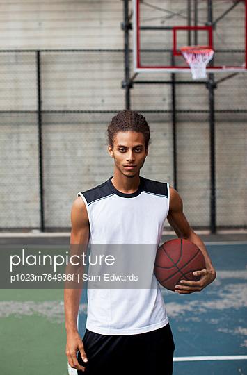 Man standing on basketball court