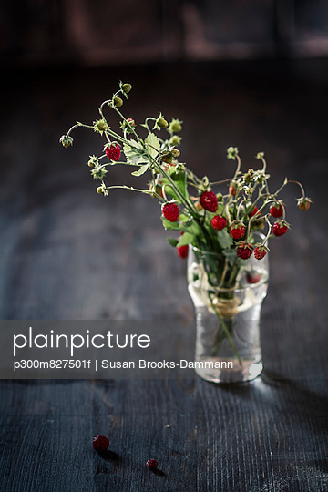 Bouquet of wild strawberries in glass