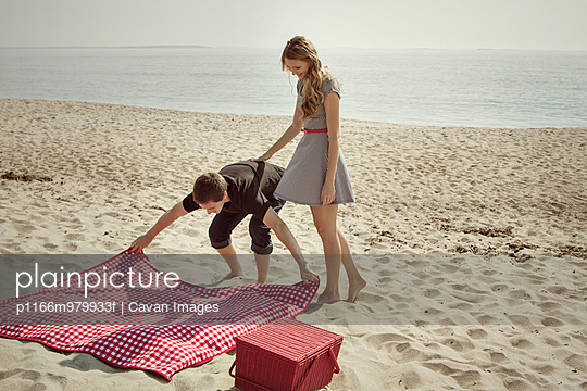 Couple having picnic on the beach