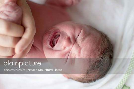New born baby crying, overhead view