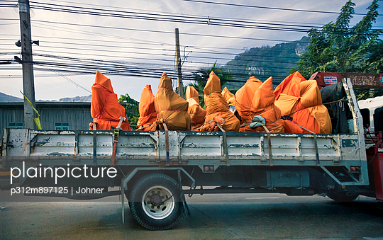 Covered sculptures on back of lorry, Thailand