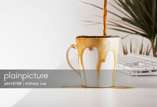 Close up of coffee overflowing cup