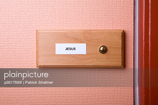 \'Jesus' name sticker next to doorbell
