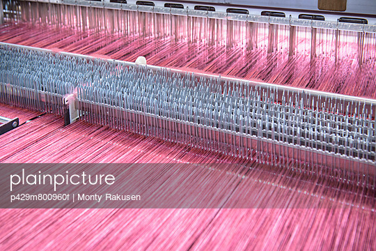 Thread on loom in textile mill