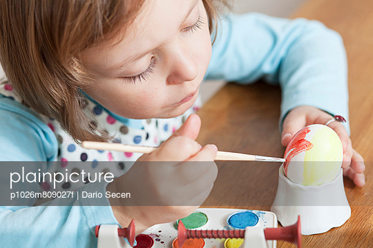 Little girl coloring Easter eggs, Munich, Bavaria, Germany
