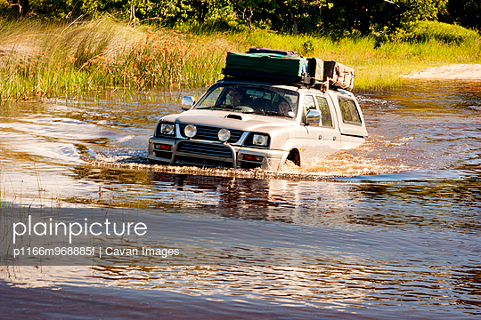 Safari Vehicle Driving Through Water