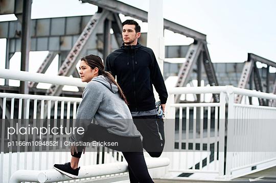 Determined athletes exercising on Bay Bridge