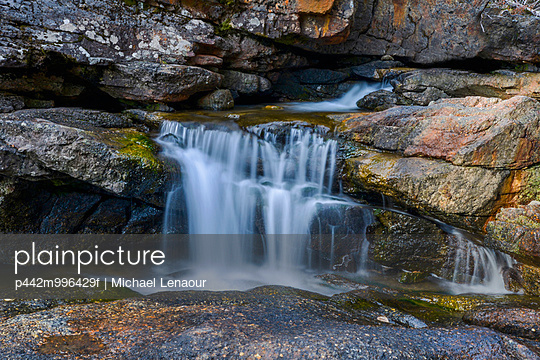 Waterfall over rocks; Fernie, British Columbia, Canada