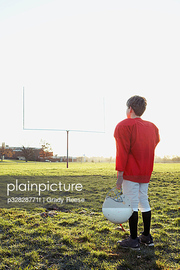 Boy standing in football field