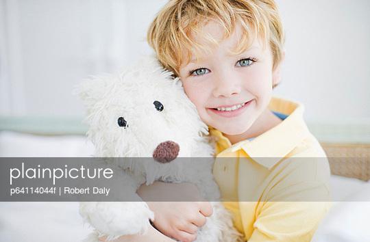 Smiling boy hugging teddy bear