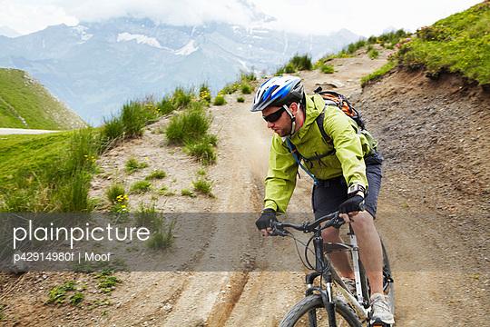 Mountain biker on dirt road