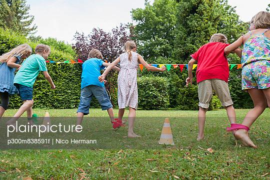 Children playing in garden on a birthday party