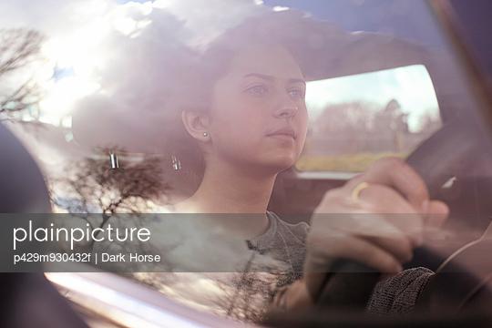 Girl behind wheel of car