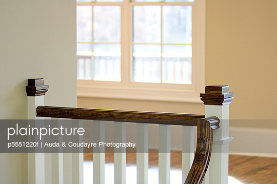 wood railing at top of staircase