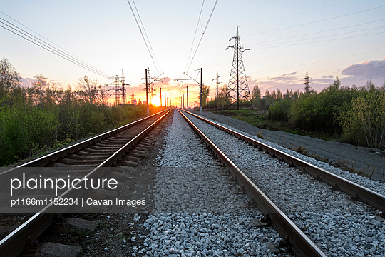 View of railroad tracks during sunset