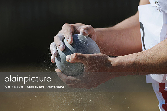 Athlete Holding Metal Ball