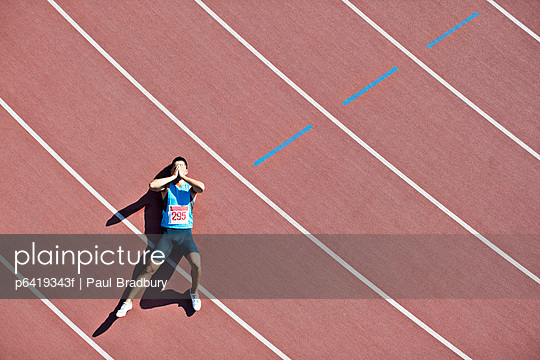 Tired runner laying on track
