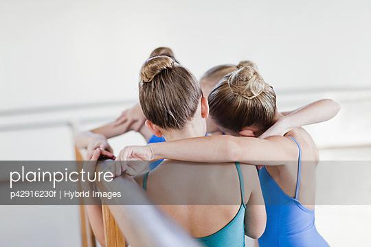 Ballet dancers talking in studio