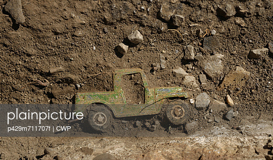 Truck compounded in dirt and stones