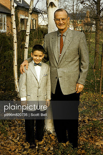 1950\'s family photo of a father and son in suit and ties