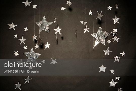 Stars hanging in black background