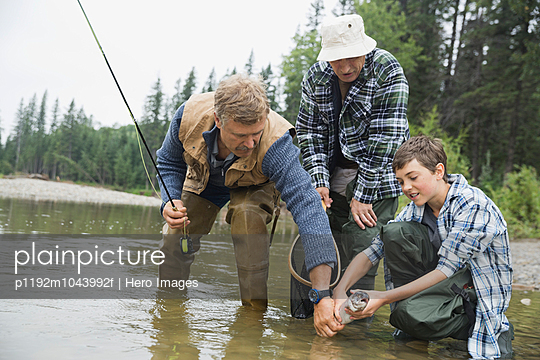 Male family members fishing together