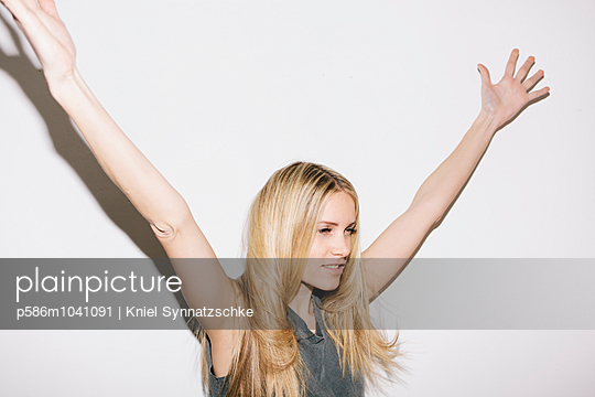 Blond woman reaching out