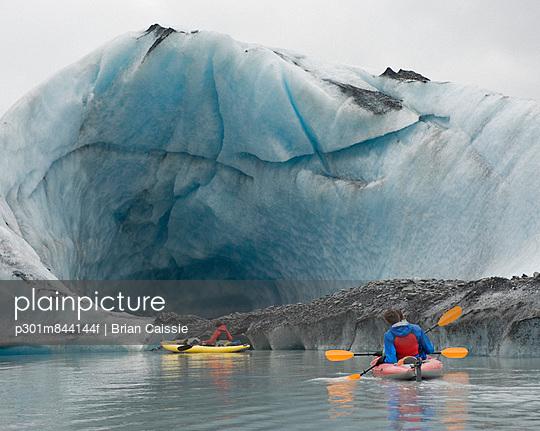 Kayaking beside ice cave at Valdez Glacier; Alaska; USA
