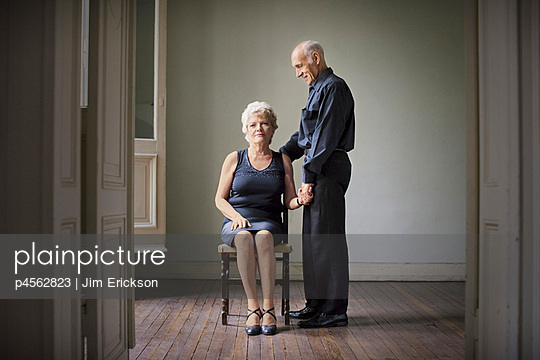 Couple holding hands and posing for portrait