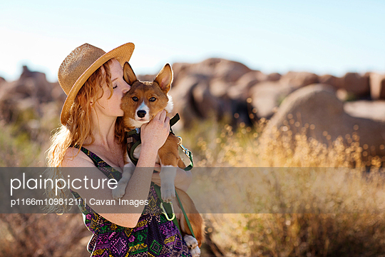 Woman kissing red dog
