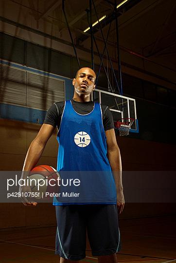 Single basketball player and ball