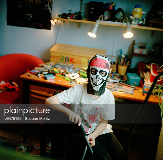 Boy with Halloween Mask sitting on chair