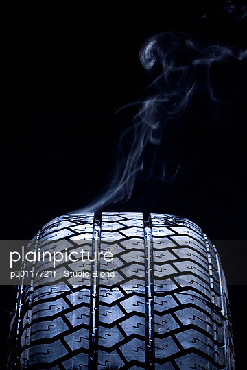 Detail of smoke coming from a car tire