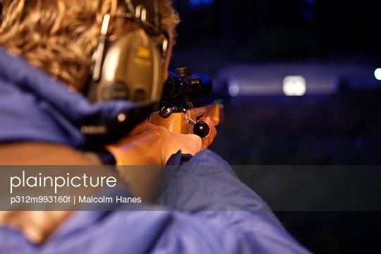 Young man practicing shooting