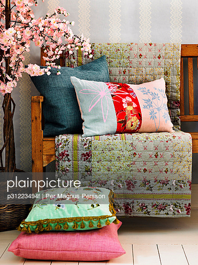 Cushions on and next to an armchair