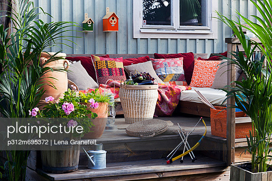 Patio with sofa and plants