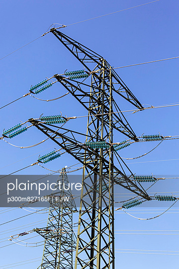Upper View of High voltage towers against sky