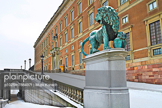 Stockholm castle with lion sculpture in foreground at Sweden
