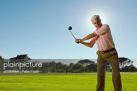 Golfer swinging a golf wood
